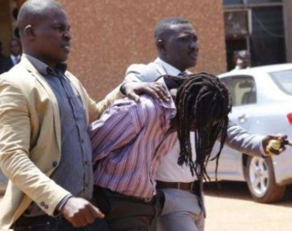 Gregory Afoko being dragged out of court