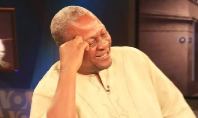 John Mahama laughing