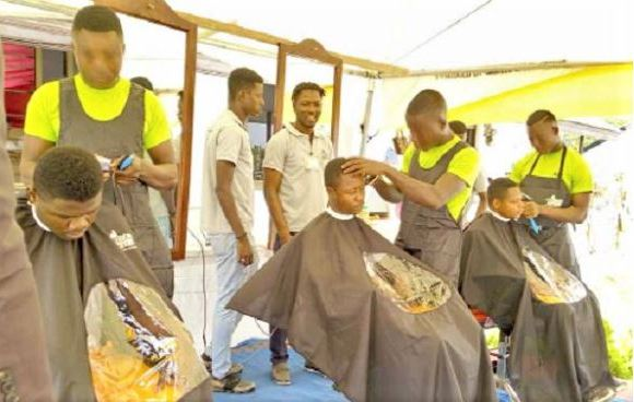 Some of the barbers displaying their skills at the function