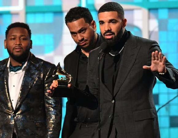 Drake giving a speech after receiving his Grammy award