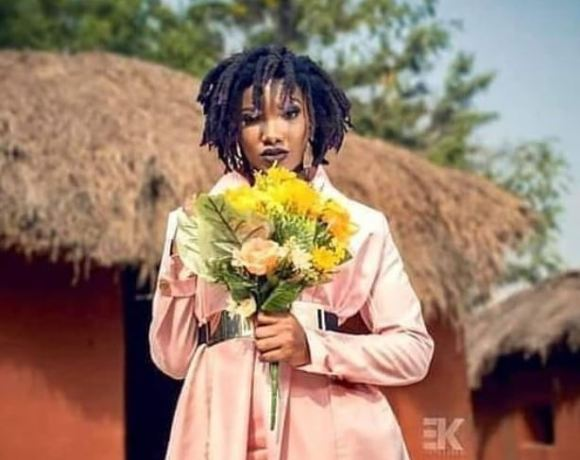 Ebony Reigns holds flowers