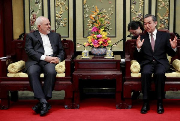 Iranian Foreign Minister Mohammad Javad Zarif (L) and his Chinese counterpart Wang Yi