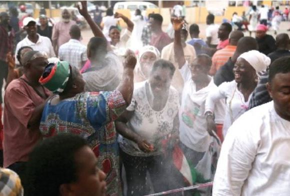 Jubilant supporters of the NDC at the party headquarters in Accra
