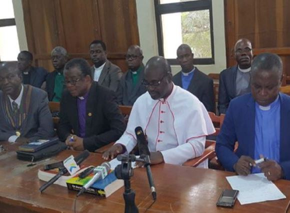 Rt. Rev. Christopher Nyarko Andam (in white robe) during a press conference