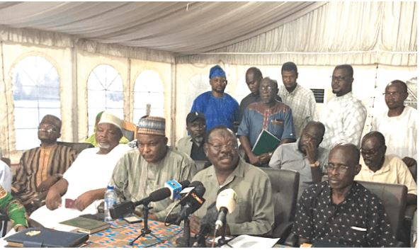 Sheikh I.C Quaye (middle), Chairman of the Pilgrimage Affairs Office of Ghana (PAOG) addressing the media