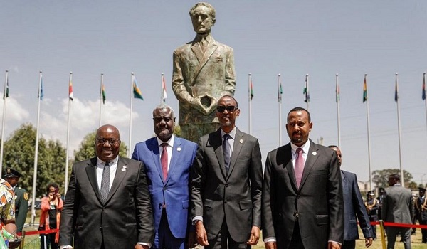 Some African leaders pose in a picture beside Haile Selassie's statue