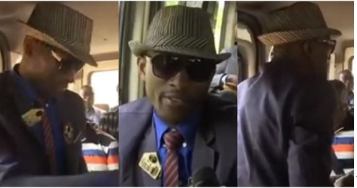 Ghanaian commuter bus conductor