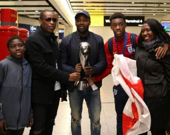 Hudson-Odoi with his family and dad (Bismark) second from left. His mum is first from right