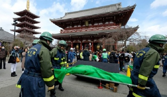 Members of the local fire brigade take part in a disaster drill at Sensoji Temple in Tokyo