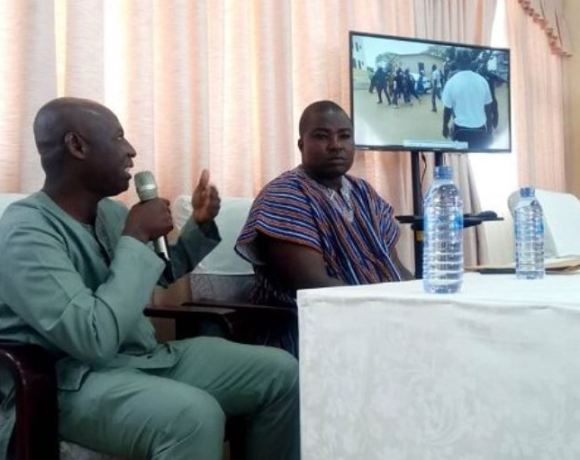 Sulemana (right) with his interpreter at the Commission hearing whilst the video is being shown