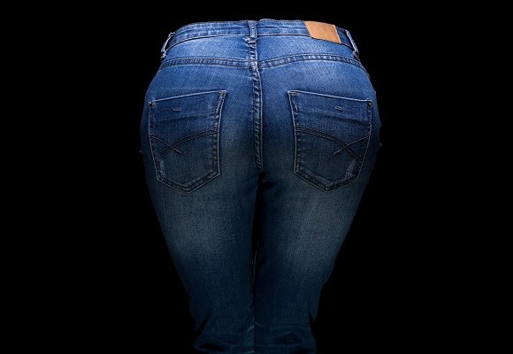 Woman's buttocks and blue jeans