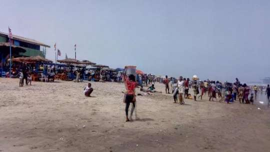 Some people enjoying at the titanic beach in Tema to climax the Easter festivities