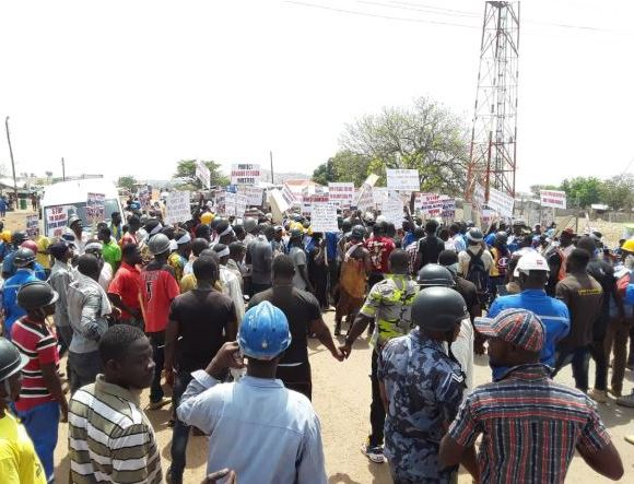 Workers of Shaanxi Mining Ghana Limited on the streets
