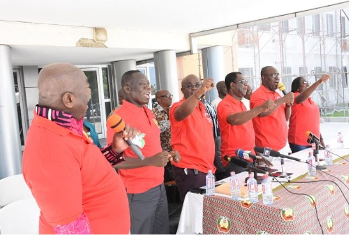 Dr Yaw Baah(second from right) and other executives chanting