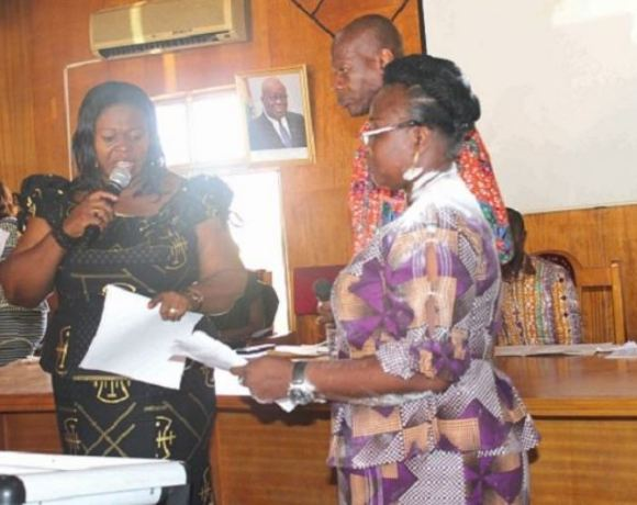 Mrs Kumi-Richardson (left) swearing in Mrs Justina Owusu-Banahene into office