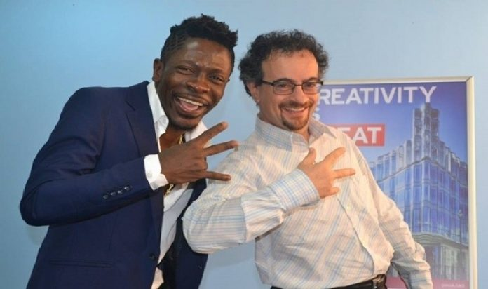 Musician Shatta Wale and Former British High Commissioner, Jon Benjamin