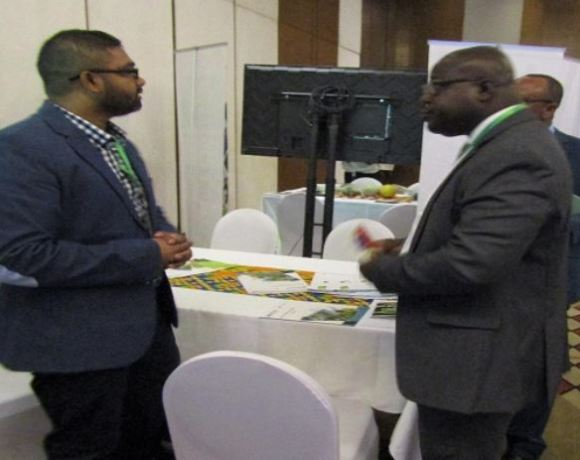 An Israeli exhibitor explaining issues to some Ghanaians