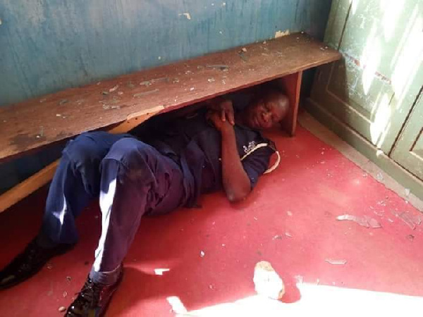 Policeman take cover during attack