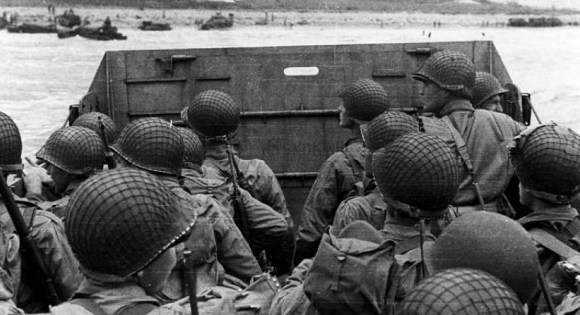U.S. Army troops in an LCVP landing craft approach Normandy's