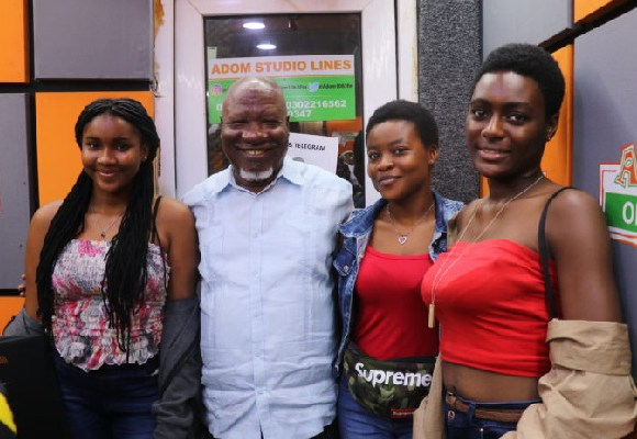 Allotey Jacobs with his granddaughters