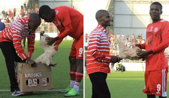 Hassan Kajoke being receiving a live chicken for winning the MoTM against Karonga