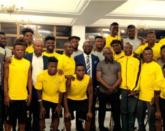 The GFA President in a pose with team members of the Black Meteors