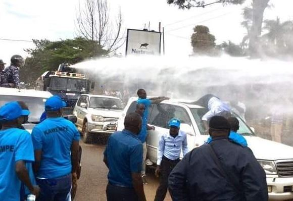 Besigye violently knock off by water canon