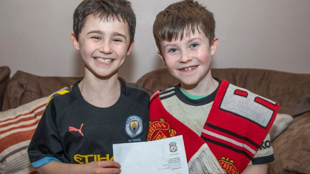 Daragh (right) and his brother Dylan with his letter from Jurgen Klopp.