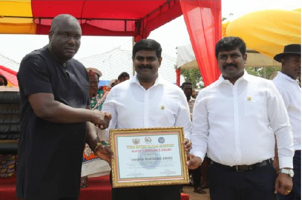 The two suspects, James Rajamani and his brother receiving an award