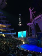 "Acrobats fly over the audience and dive into a pool of fountains during ""OceanAria."""