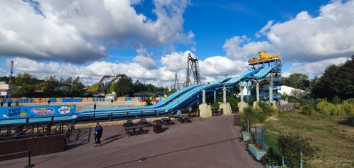 View of theme park ride and blue sky