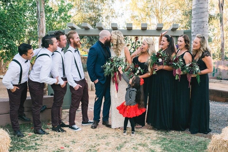 suspenders and bowties, vintage wedding, black bridesmaid dresses, gold wedding dress, circus wedding, sweet petals florist, backyard wedding, menifee wedding