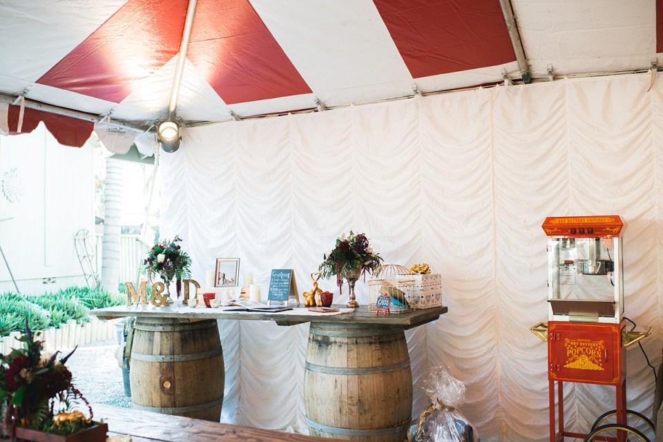 backyard vintage carnival wedding, weddings under the big top, whiskey barrels at weddings, popcorn bar at weddings