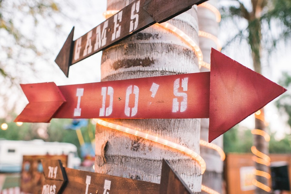 backyard vintage carnival wedding, I do's sign, wedding signs, homemade wedding decor