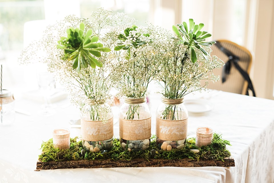 DIY moss and candle wedding centerpieces