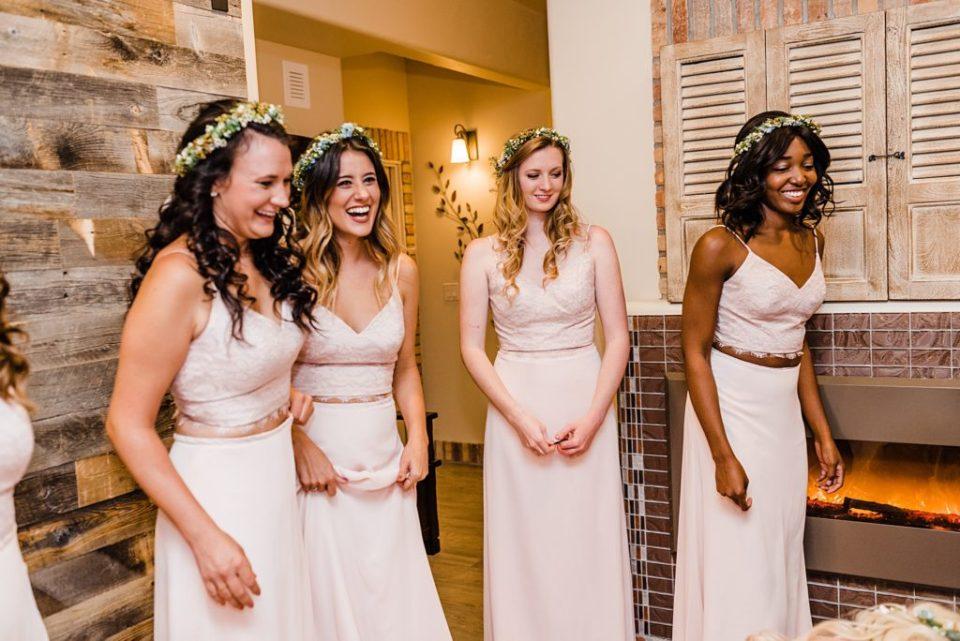 bridesmaids watching bride getting dressed