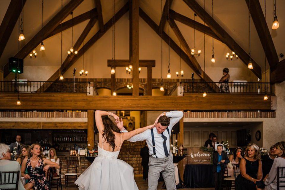 bride and groom dancing at della terra