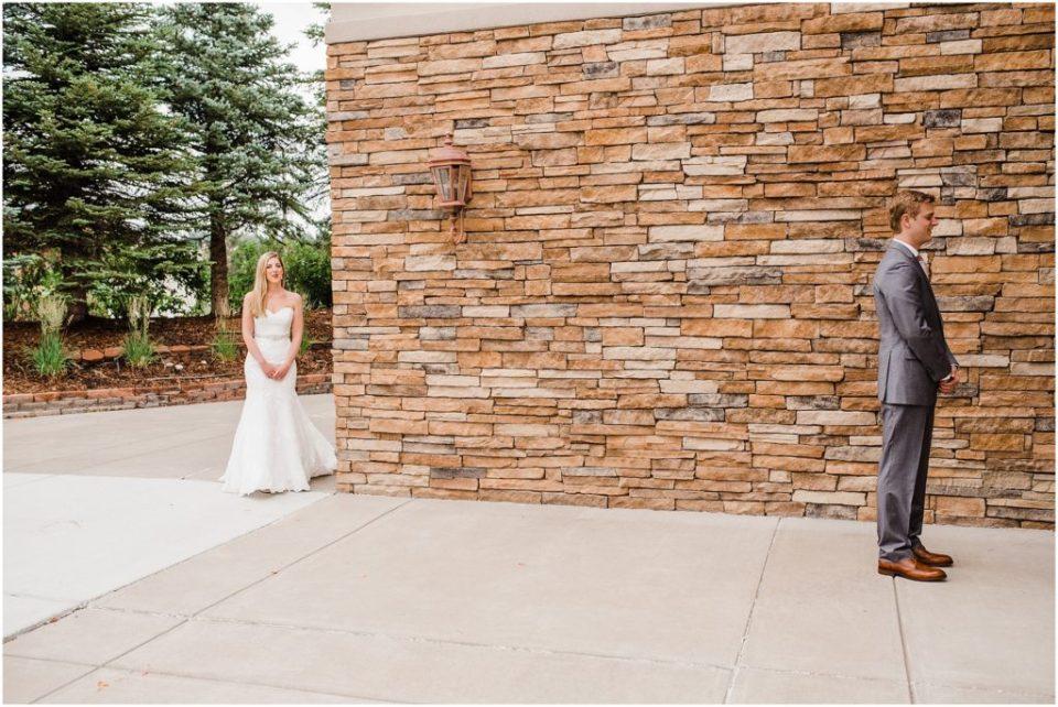 bride peeking around corner for first look