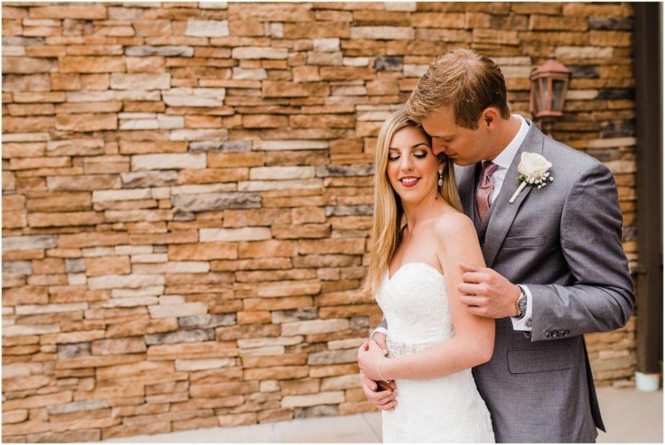 groom sweetly whispering in brides ear