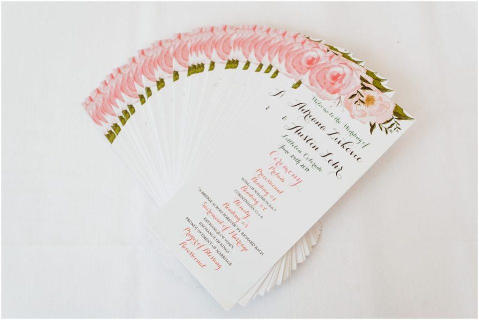 wedding ceremony program with pink flowers