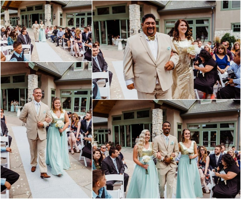 wedding party walking down the aisle at cielo at castle pines