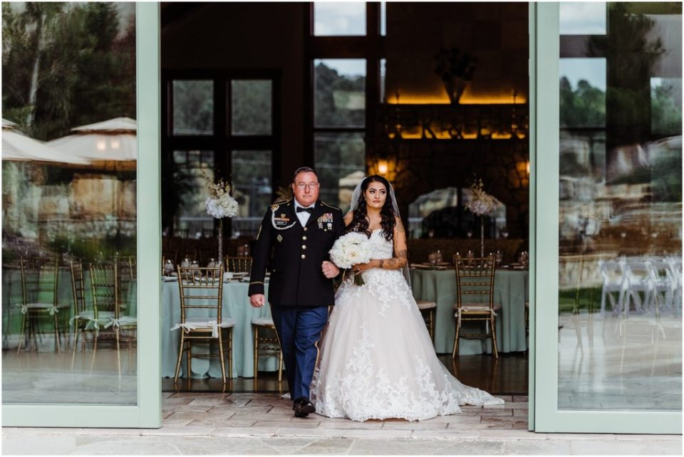 army dad walking daughter down the aisle