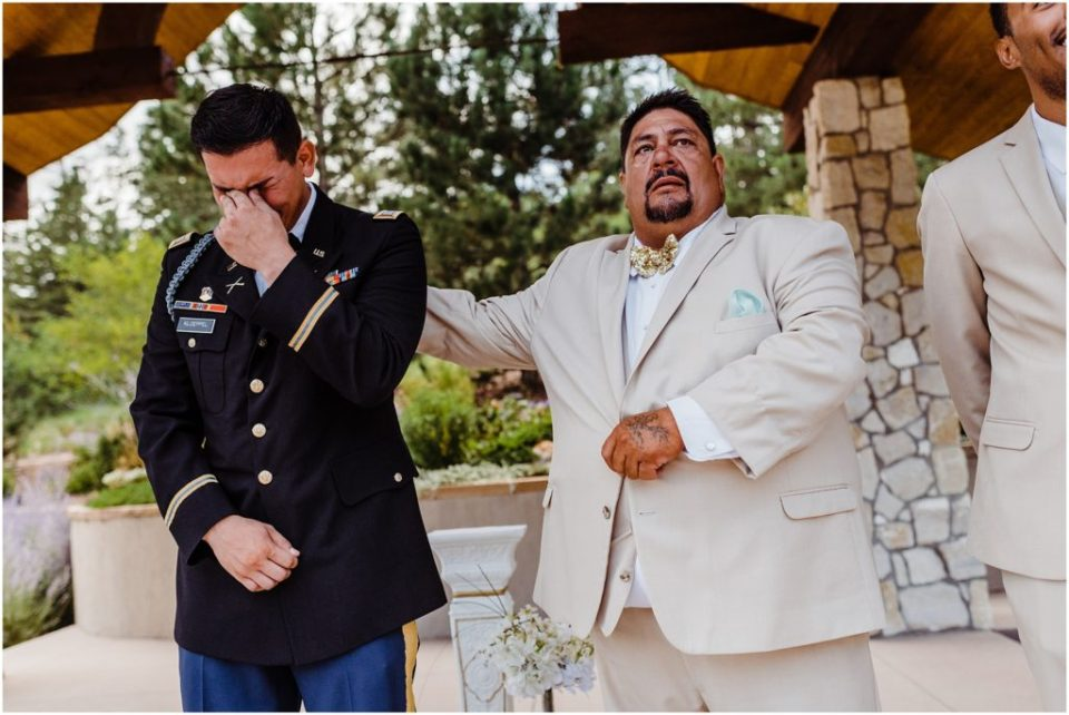 father of the groom comforting son