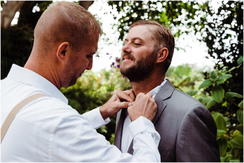 groom's brother helping him get ready