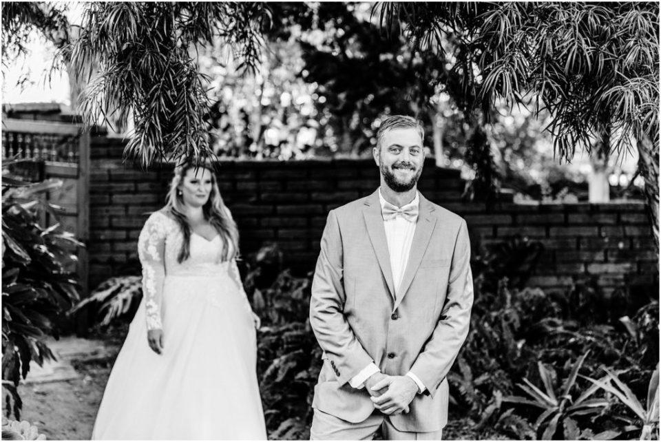 bride sneaking up on groom
