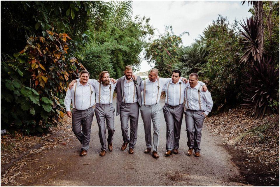 unposed groomsmen party portraits