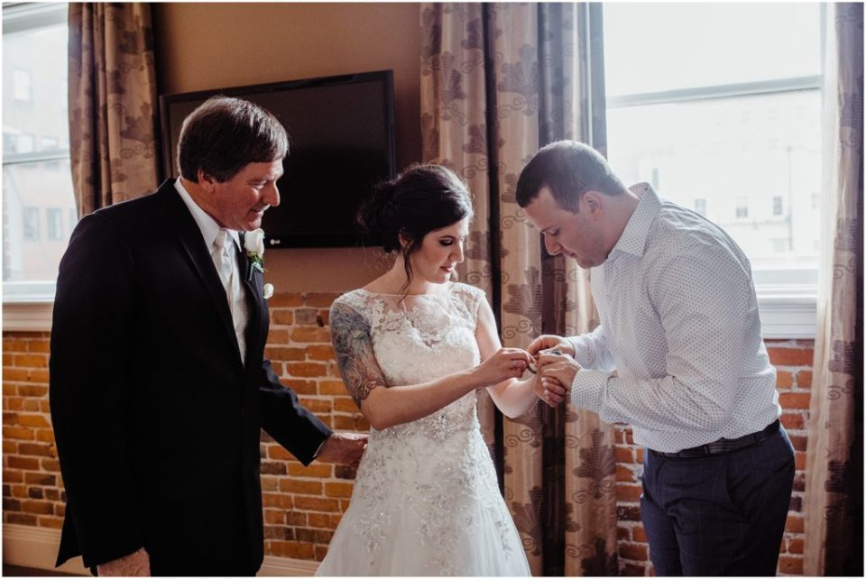bride getting gift from brother and father