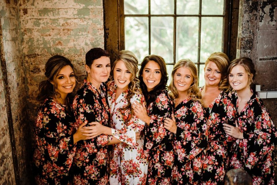 bride with bridesmaids in matching robe