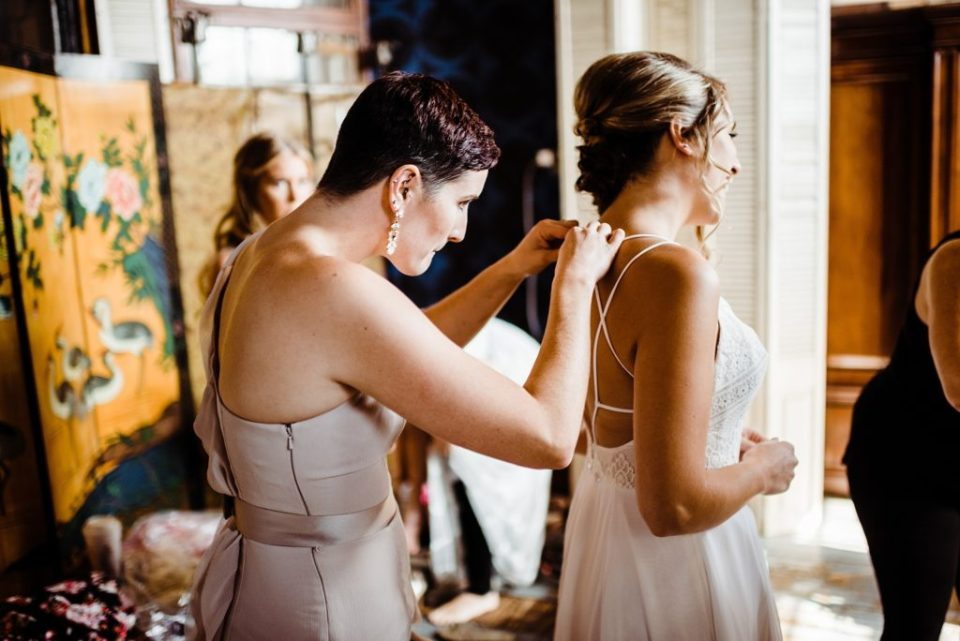 bride getting dressed at the metropolitan building in queens