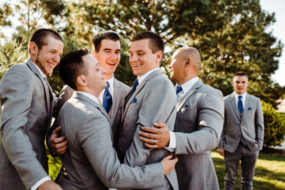 groomsmen congratulating groom